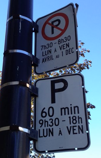 Monolingual parking restrictions sign